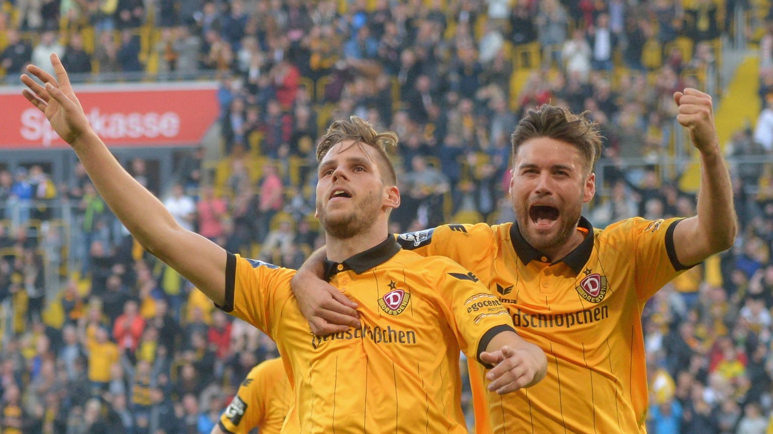 DRESDEN, GERMANY - OCTOBER 31:  Justin Eilers (L) of Dresden celebrates after scoring 3:1 with Niklas Kreuzer during the Third League match between SG Dynamo Dresden and 1. FC Magdeburg at Stadion Dresden on October 31, 2015 in Dresden, Germany.  (Photo by Thomas Eisenhuth/Bongarts/Getty Images)