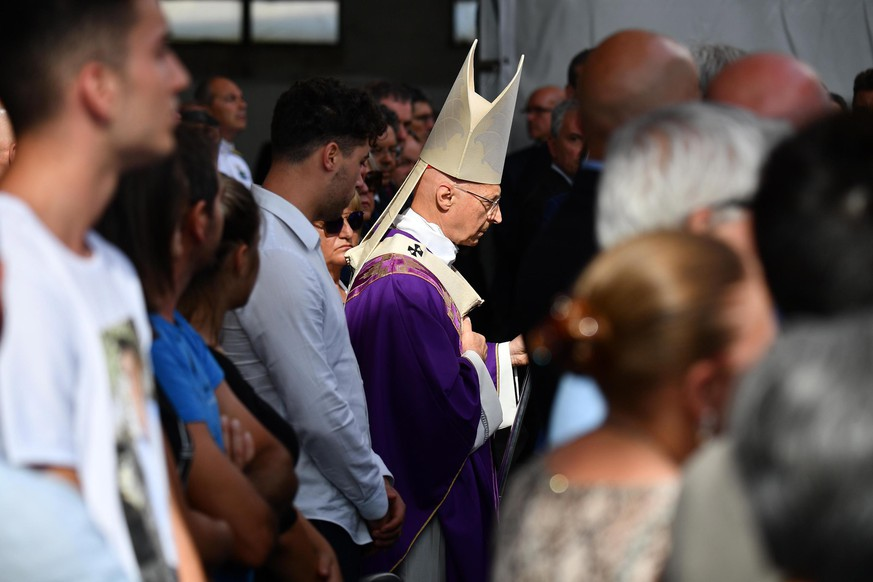 epa07772593 Archbishop of Genoa, Italian cardinal Angelo Bagnasco during a memorial ceremony for the victims on the first anniversary of the Morandi highway bridge collapse, in Genoa, northern Italy, 14 August 2019. The motorway bridge partially collapsed on 14 August 2018, killing 43 people.  EPA/LUCA ZENNARO