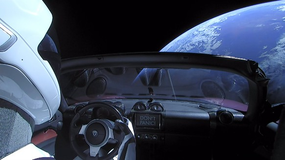 epa06506018 A handout photo made available by SpaceX on 08 Ferbuary 2018 shows a Tesla Roadster car in space after being launched with the SpaceX Falcon Heavy rocket, 06 February 2018. SpaceX, founded by Elon Musk, launched its Falcon Heavy rocket, the most powerful rocket in the world. As part of its payload the Falcon Heavy is carrying Musk's cherry red Roadster from Tesla, his electric car company.  EPA/SPACEX /  HANDOUT  HANDOUT EDITORIAL USE ONLY/NO SALES