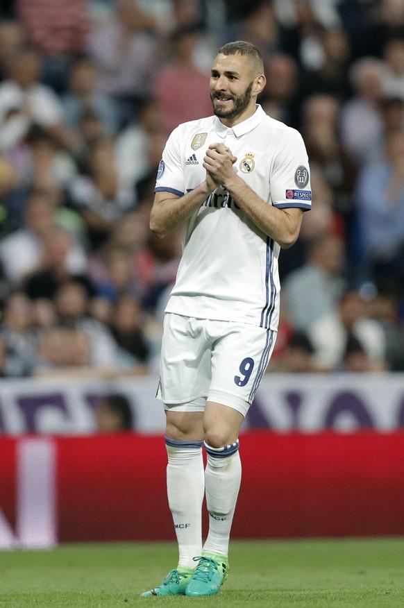 Real Madrid's Karim Benzema reacts during the Champions League quarterfinal second leg soccer match between Real Madrid and Bayern Munich at Santiago Bernabeu stadium in Madrid, Spain, Tuesday April 18, 2017. (AP Photo/Daniel Ochoa de Olza)