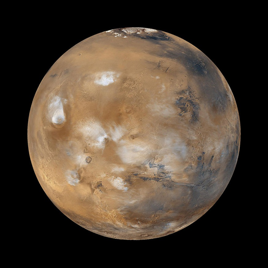 Mars, der Rote Planet https://de.wikipedia.org/wiki/Mars_(Planet)#/media/File:Water_ice_clouds_hanging_above_Tharsis_PIA02653_black_background.jpg