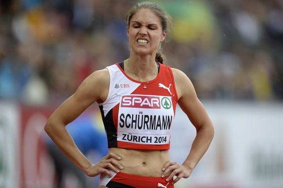 Robine Schuermann from Switzerland reacts after the women's 400m hurdles round 1 race, at the second day of the European Athletics Championships in the Letzigrund Stadium in Zurich, Switzerland, Wednesday, August 13, 2014. (KEYSTONE/Steffen Schmidt)