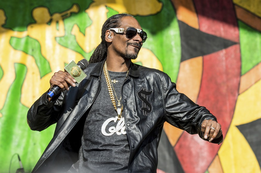 FILE - In this May 6, 2017, file photo, Snoop Dogg performs at the New Orleans Jazz and Heritage Festival in New Orleans. Snoop Dogg says he wants to create a music festival in his father's hometown so he can perform in Mississippi. (Photo by Amy Harris/Invision/AP, File)