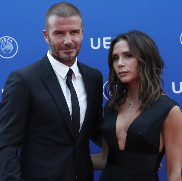 epa06984431 British former soccer player David Beckham (L) and his wife, British fashion designer Victoria Beckham arrive for the UEFA Champions League Group Stage Draw and Awards in Monaco, 30 August 2018.  EPA/GUILLAUME HORCAJUELO