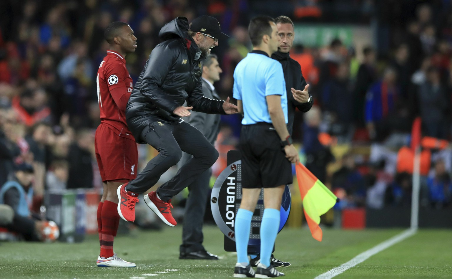 Liverpool manager Jurgen Klopp gestures on the touchline during the Champions League Semi Final, second leg soccer match between Liverpool and Barcelona at Anfield, Liverpool, England, Tuesday, May 7, 2019. Liverpool won the match 4-0 to overturn a three-goal deficit to win the match 4-3 on aggregate. (Peter Byrne/PA via AP)