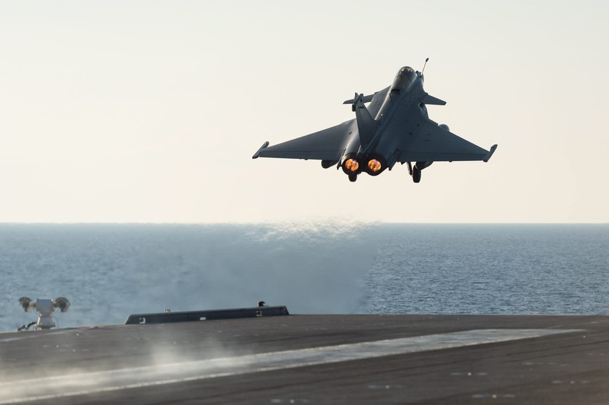 epa05038864 A handout picture issued by the French Ministry of Defense on 23 November 2015 shows a French military jet part of the Mission Arromanches 2 in Iraq against the Islamic State group taking off from the Charles de Gaulle aircraft carrier, deployed in the Mediterranean Sea, 23 November 2015. The French Air Force on 15 November 2015 launched a massive campaign of airstrikes against IS. The airstrikes come after 130 people were killed and some 350 injured in the terror attacks which targeted the Bataclan concert hall, the Stade de France national sports stadium, and several restaurants and bars in Paris on 13 November.  EPA/ECPAD / HANDOUT TO BE USED WITHIN 30 DAYS FROM 23 NOVEMBER 2015 HANDOUT EDITORIAL USE ONLY/NO SALES