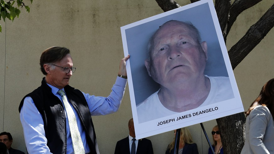 epa06693047 An official puts a mug shot on an easel stand, of the suspect identified as Joseph James DeAngelo, 72, a former police officer in Visalia and Auburn, California before a press conference at the District Attorney Crime Lab in Sacramento, California, USA, 25 April 2018. He is known as the Golden State Killer and suspected serial killer and rapist in the 1970's and '80's.  EPA/JOHN G. MABANGLO