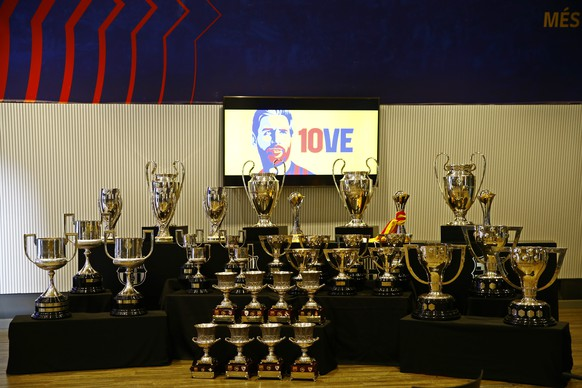 Trophies won while Lionel Messi played for Barcelona are displayed before a press conference at the Camp Nou stadium in Barcelona, Spain, Sunday, Aug. 8, 2021. FC Barcelona had previously announced the negotiations with Lionel Messi had ended and that Messi would be leaving the club. (AP Photo/Joan Monfort)
