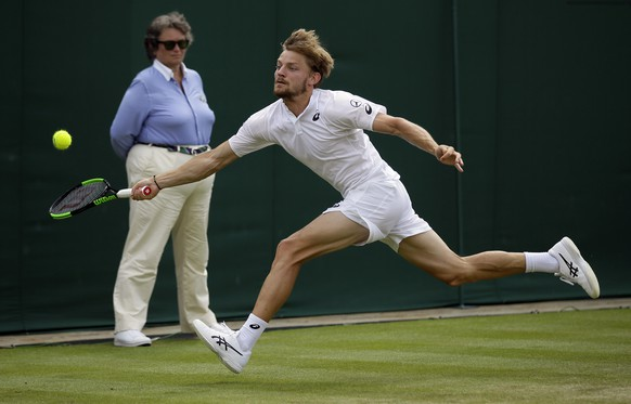 Belgium's David Goffin returns to Spain's Fernando Verdasco in Men's a singles match during day seven of the Wimbledon Tennis Championships in London, Monday, July 8, 2019. (AP Photo/Tim Ireland)