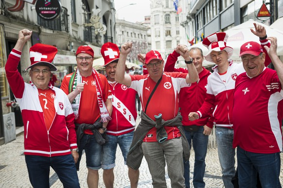 Supporters from Switzerland pose in the street before the UEFA Nations League semi-final soccer match between Portugal and Switzerland at the Dragao stadium in Porto, Portugal, on Wednesday, June 5, 2019. (KEYSTONE/Jean-Christophe Bott)