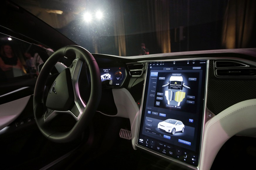 FILE - This Tuesday, Sept. 29, 2015, file photo shows the dashboard of the Tesla Model X car, at the company's headquarters in Fremont, Calif. Newer cars that connect to the internet are capable of collecting vast amounts of data about their drivers. Tesla Motors has used data to reveal, sometimes within hours of a crash, how fast the driver was going and whether or not the company's semi-autonomous Autopilot system was engaged. (AP Photo/Marcio Jose Sanchez, File)