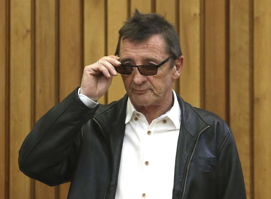 AC/DC drummer Phil Rudd appears in the Tauranga District Court in Tauranga, New Zealand Monday, Aug. 3, 2015. Rudd pleaded not guilty on Monday to breaching the rules of his home detention sentence by drinking alcohol. (Alan Gibson/New Zealand Herald via AP) NEW ZEALAND OUT, AUSTRALIA OUT