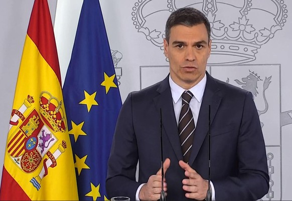 epa08439240 A handout Video-grab photo taken from La Moncloa Palace official broadcasting shows  Spanish Prime Minister, Pedro Sanchez, as he addresses a press conference at La Moncloa Palace, in Madrid, Spain, 23 May 2020. Sanchez reported on situation amid coronavirus lockdown exit plan.  EPA/LA MONCLOA  HANDOUT  HANDOUT EDITORIAL USE ONLY/NO SALES
