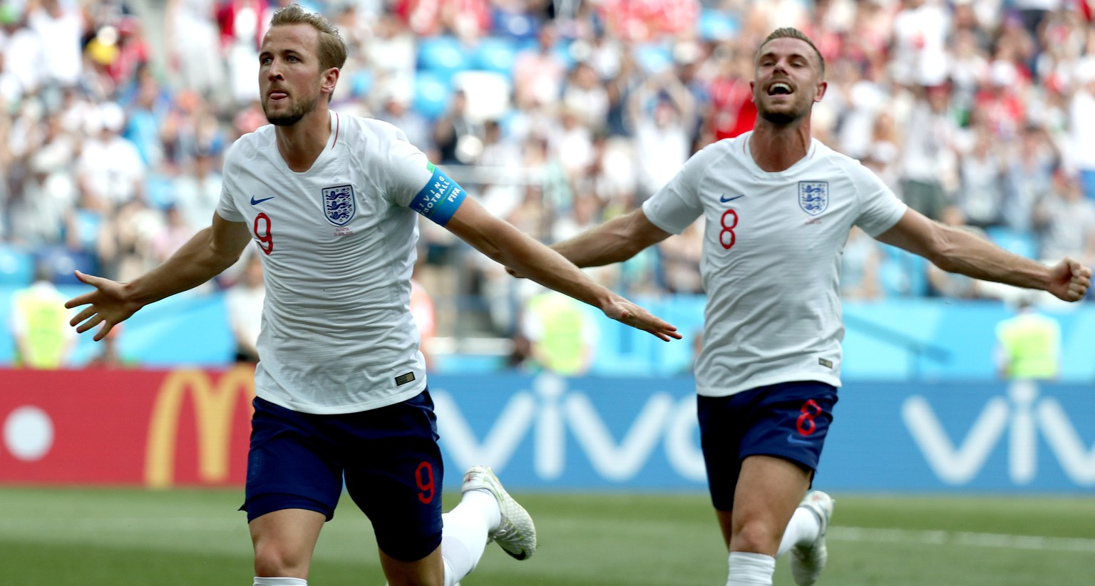 epa06835792 Harry Kane of England (L) reacts with Jordan Henderson of England after scoring the 2-0 during the FIFA World Cup 2018 group G preliminary round soccer match between England and Panama in Nizhny Novgorod, Russia, 24 June 2018.