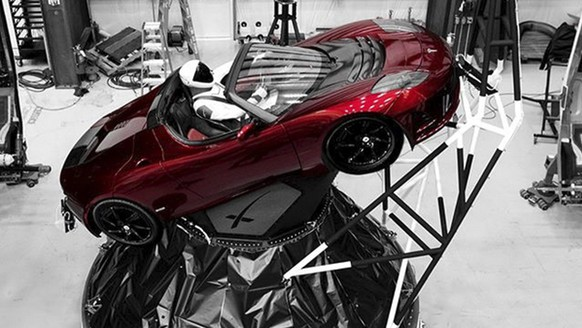 "A mannequin ""Starman"" sits at the wheel of a Tesla Roadster in this photo posted on the Instagram account of Elon Musk, head of auto company Tesla and founder of the private space company SpaceX. The car will be on board when SpaceX launches its new rocket, the Falcon Heavy, from Kennedy Space Center at Cape Canaveral, Fla., scheduled for Tuesday, Feb. 6, 2018. (Courtesy of Elon Musk/Instagram via AP)"