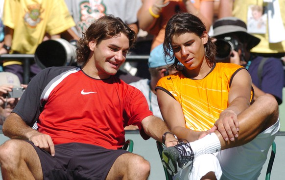 Roger Federer, left, of Switzerland and Rafael Nadal of Spain have a light moment after the men's singles final at the Nasdaq 100 Open, Sunday, April 3, 2005 at Key Biscayne, Fla. Federer won 2-6, 6-7 (4), 7-6 (5), 6-3, 6-1. (AP Photo/Steve Mitchell)
