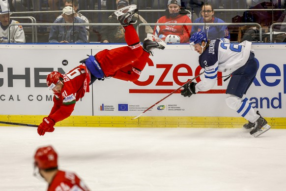 OSTRAVA, CZECH REPUBLIC - MAY 11:  Jyrki Jokipakka (R) of Finland and Artur Gavrus (L) of Belarus battle for the puck during the IIHF World Championship group B match between Finland and Belarus at CEZ Arena on May 11, 2015 in Ostrava, Czech Republic.  (Photo by Matej Divizna/Getty Images) *** BESTPIX ***