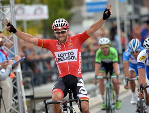 Belgian Jonas Van Genechten of Lotto - Belisol celebrates as he crosses the finish line to win the 54th  Druivenkoers cycling race, on August 27, 2014 in Overijse. AFP PHOTO /DAVID STOCKMAN