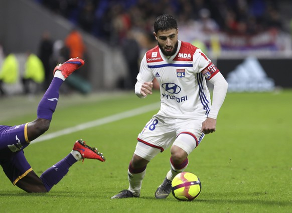 Lyon forward Nabil Fekir controls the ball during the French League One soccer match between Lyon and Toulouse, in Decines, near Lyon, central France, Sunday, March 3, 2019. (AP Photo/Laurent Cipriani)