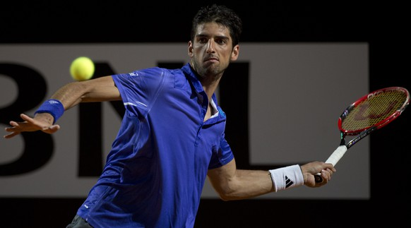 Thomaz Bellucci, of Brazil, returns the ball to Novak Djokovic, of Serbia, during their match at the Italian Open tennis tournament, in Rome, Thursday, May 14, 2015. (AP Photo/Andrew Medichini)