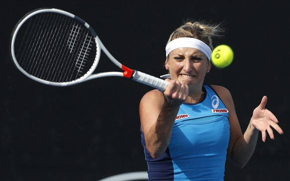 Switzerland's Timea Bacsinszky makes a forehand return to Italy's Camila Giorgi during their first round match at the Australian Open tennis championships in Melbourne, Australia, Tuesday, Jan. 17, 2017. (AP Photo/Kin Cheung)