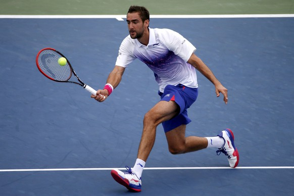 Marin Cilic of Croatia hits a return to Mikhail Kukushkin of Kazakhstan during their match at the U.S. Open Championships tennis tournament in New York, September 4, 2015. REUTERS/Mike Segar