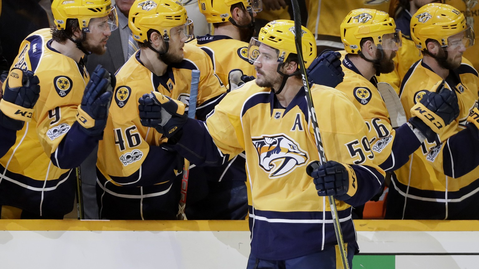 Nashville Predators defenseman Roman Josi (59), of Switzerland, is congratulated after scoring the go-ahead goal during the third period in Game 3 of the Western Conference final in the NHL hockey Stanley Cup playoffs Tuesday, May 16, 2017, in Nashville, Tenn. The Predators won 2-1. (AP Photo/Mark Humphrey)