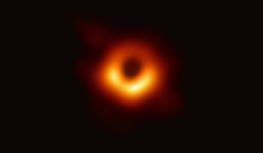 epa07496265 An undated handout photo made available by Event Horizon Telescope Collaboration on 10 April 2019 showing a bright ring formed as light bends in the intense gravity around a black hole that is 6.5 billion times more massive than the Sun. Scientists have obtained the first image of a black hole, using Event Horizon Telescope observations of the center of the galaxy M87. This long-sought image provides the strongest evidence to date for the existence of supermassive black holes and opens a new window onto the study of black holes, their event horizons, and gravity.  EPA/EVENT HORIZON TELESCOPE COLLABORATION / HANDOUT  HANDOUT EDITORIAL USE ONLY/NO SALES