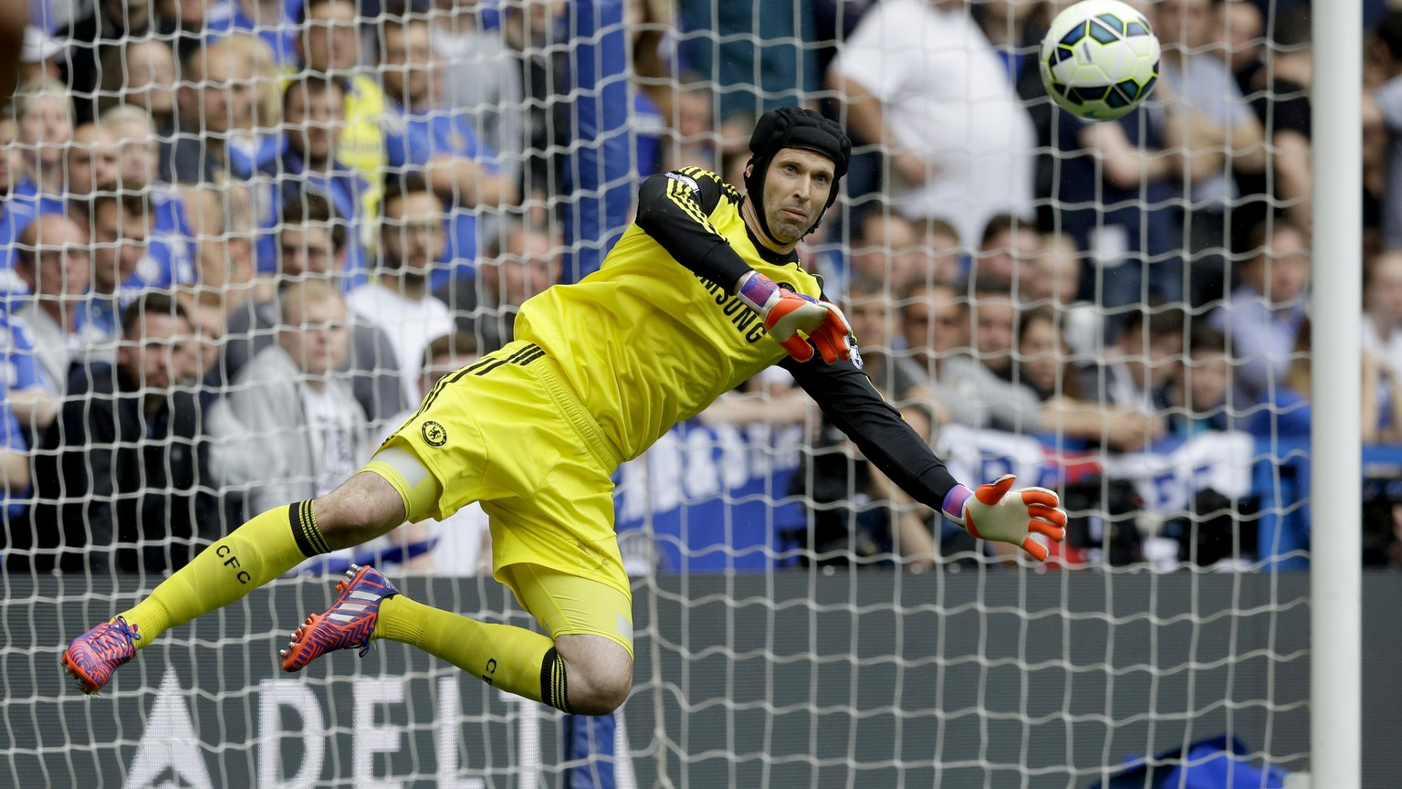 FILE - In this Sunday, May 24, 2015 file photo, Chelsea's goalkeeper Petr Cech makes a save during the English Premier League soccer match between Chelsea and Sunderland at Stamford Bridge stadium in London. Goalkeeper Cech ended his trophy-filled, 11-year stay at Chelsea by signing for Premier League rival Arsenal on Monday, June 29, 2015 after losing his starting place at the English champions. (AP Photo/Matt Dunham, File)