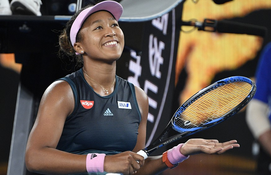 Japan's Naomi Osaka celebrates after defeating Karolina Pliskova of the Czech Republic in their semifinal at the Australian Open tennis championships in Melbourne, Australia, Thursday, Jan. 24, 2019. (AP Photo/Andy Brownbill)