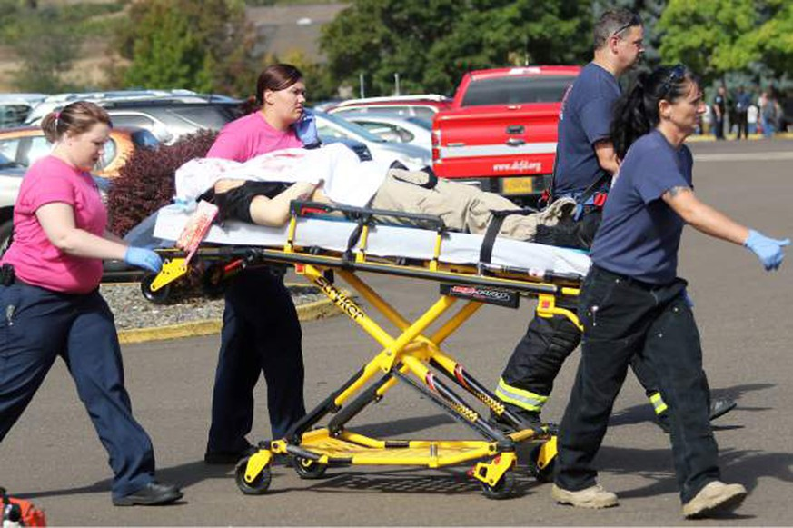 First responders transport an injured person following a shooting incident at Umpqua Community College in Roseburg, Oregon October 1, 2015. A gunman opened fire on Thursday at a community college in Oregon, killing 13 people and wounding some 20 others before he was shot to death by law enforcement, in the latest mass killing to rock a U.S. school, the state attorney general and county sheriff said.    REUTERS/Michael Sullivan/The News-Review  NO SALES. NO ARCHIVES. FOR EDITORIAL USE ONLY. NOT FOR SALE FOR MARKETING OR ADVERTISING CAMPAIGNS. MANDATORY CREDIT TPX IMAGES OF THE DAY