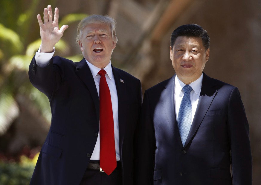 FILE - In this Friday, April 7, 2017, file photo, U.S. President Donald Trump, left, and Chinese President Xi Jinping pause for photographs at Mar-a-Lago in Palm Beach, Fla. North Korea often marks significant dates by displaying military capability, and South Korean officials say there's a chance the country will conduct its sixth nuclear test or its maiden test launch of an ICBM around the founding anniversary of its military on Tuesday, April 25. Trump spoke by phone with both the Japanese and Chinese leaders Monday, April 24. China's official broadcaster CCTV quoted Xi telling Trump that China strongly opposed North Korea's nuclear weapons program and hoped