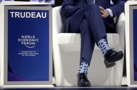 Justin Trudeau, Prime Minister of Canada, wears light blue socks with black dots prior to his special address on corporate responsibility and the role of women in a changing world during the annual meeting of the World Economic Forum in Davos, Switzerland, Tuesday, Jan. 23, 2018. (AP Photo/Markus Schreiber)