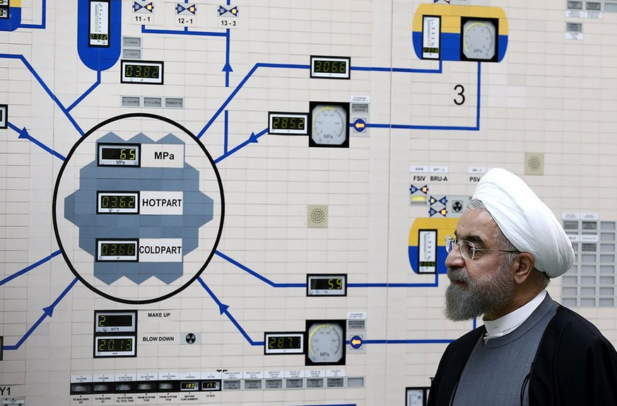 epa07687228 (FILE) - A handout file picture made available by the Iranian Presidency Office shows Iranian President Hassan Rouhani visiting the Bushehr nuclear power plant in the city of Bushehr, southern Iran, 13 January 2015 (reissued 01 July 2019). According to Iranian media on 01 July 2019, Iran has passed the limit on its stockpile of low-enriched uranium by exceeding of 300kg set in a landmark 2015 nuclear deal made with world powers. The International Atomic Energy Agency (IAEA) said it will file a report.  EPA/IRANIAN PRESIDENCY OFFICE HANDOU  HANDOUT EDITORIAL USE ONLY/NO SALES *** Local Caption *** 55176101