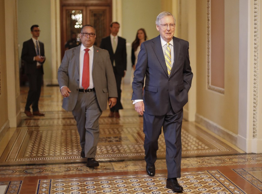 Senate Majority Leader Mitch McConnell of Ky. walks to his office on Capitol Hill in Washington Thursday, July 13, 2017. McConnell is planning on rolling out the GOP's revised health care bill, pushing toward a showdown vote next week with opposition within the Republican ranks. (AP Photo/Pablo Martinez Monsivais)