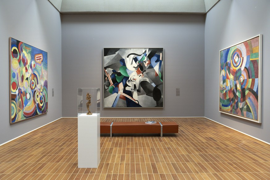epa07468531 The artworks 'Dancer' (front, 1912) by Ukrainian artist Alexander Archipenko and (back, L-R) 'Hommage to Bleriot' (1914) by French artist Robert Delaunay, 'Udnie' (1913) by French artist Francis Picaba and 'Electric Prisms' (1914) by Russian-French artist Sonia Delaunay are on display in the exhibition 'The Cubist Cosmos - From Picasso to Leger' at the Kunstmuseum Basel, in Basel, Switzerland, 28 March 2019. The show opens to the public from 30 March to 04 August.  EPA/GEORGIOS KEFALAS