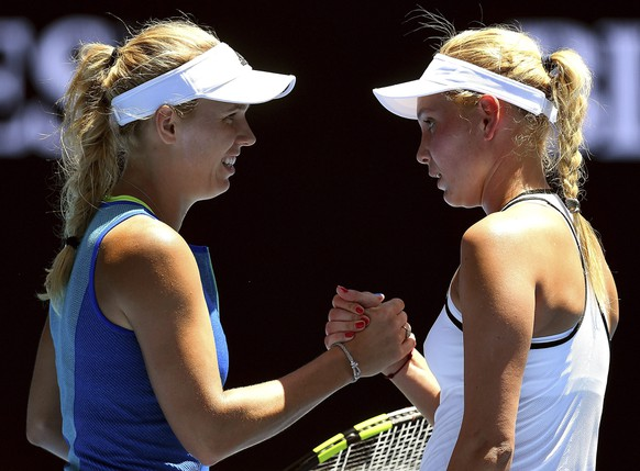 epa05729298 Caroline Wozniacki of Denmark (L) is congratulated on her win by Donna Vekic of Croatia (R) during round two of the Women's Singles at the Australian Open Grand Slam tennis tournament in Melbourne, Victoria, Australia, 19 January 2017.  EPA/DEAN LEWINS  AUSTRALIA AND NEW ZEALAND OUT