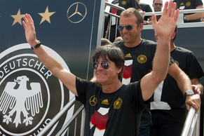 BERLIN, GERMANY - JULY 15:  Joachim Loew team arrives at Brandenburg Gate to celebrate on stage at the German team victory ceremony  July 15, 2014 in Berlin, Germany. Germany won the 2014 FIFA World Cup Brazil match against Argentina in Rio de Janeiro on July 13.  (Photo by Matthias Nareyek/Bongarts/Getty Images)