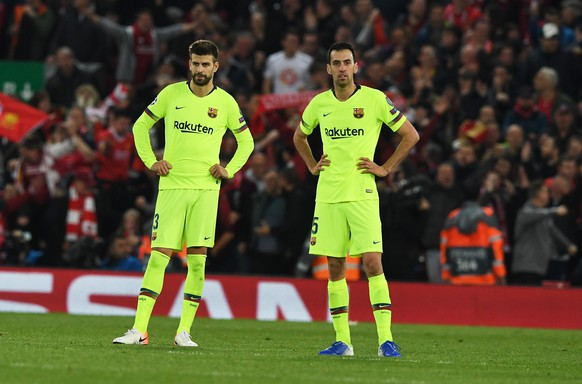 epa07554630 Gerard Pique (L) and Sergio Busquets of Barcelona react during the UEFA Champions League semi final second leg soccer match between Liverpool FC and FC Barcelona at Anfield, Liverpool, Britain, 07 May 2019.  EPA/NEIL HALL