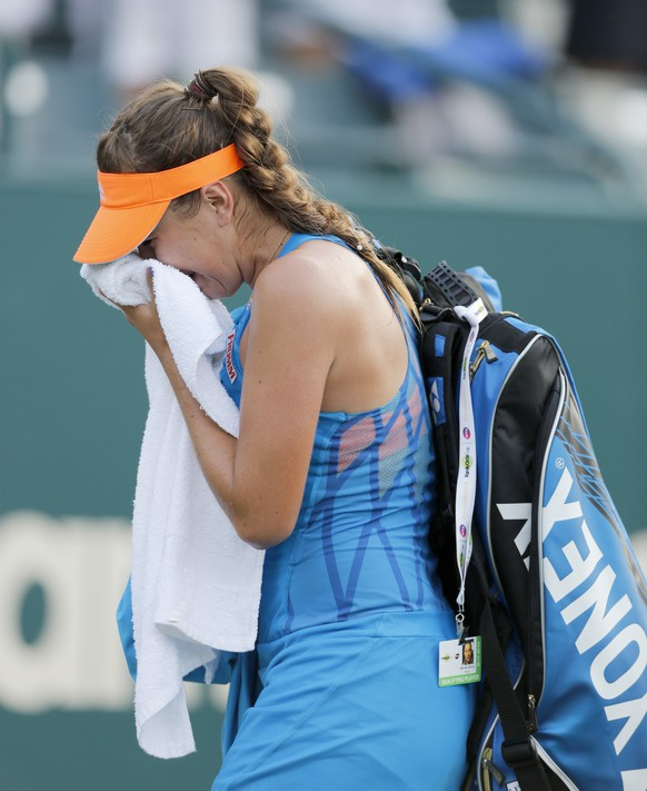 Belinda Bencic, of Switzerland, cries while walking off the court after losing to Jana Cepelova, of Slovakia, during the Family Circle Cup tennis tournament in Charleston, S.C., Saturday, April 5, 2014. Cepelova won 6-4, 5-7, 7-6 (7), to reach the finals. (AP Photo/Mic Smith)
