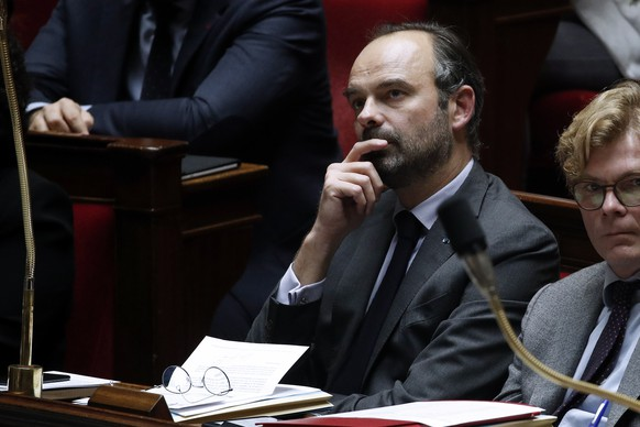 epa07208319 French Prime Minister Edouard Philippe attends the weekly session of questions to the government, at the French National Assembly in Paris, France, 04 December 2018. Media reports on 04 December 2018 state that Philippe has announced a six-month suspension of a fuel tax rise until there had been a proper debate with those affected. The announced tax has led to weeks of violent protests.  EPA/YOAN VALAT