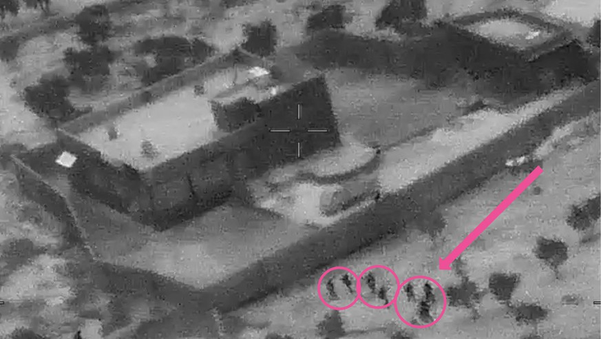 epa07961150 A screengrab from a handout military drone video made available by the US Defense Video and Imagery Distribution System (DVIDS) shows the compound of ISIS Leader Abu Bakr al-Baghdadi during the US forces (bottom) raid, northwestern Syria, 26 October 2019 (Issued 30 October 2019). US Forces killed Abu Bakr al-Baghdadi, the founder and leader of ISIS, in northwest Syria on 26 October 2019.  EPA/DVIDS HANDOUT  HANDOUT EDITORIAL USE ONLY/NO SALES
