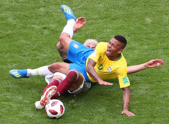 epa06858020 Gabriel Jesus (front) of Brazil in action against Carlos Salcedo (back) of Mexico during the FIFA World Cup 2018 round of 16 soccer match between Brazil and Mexico in Samara, Russia, 02 July 2018.  (RESTRICTIONS APPLY: Editorial Use Only, not used in association with any commercial entity - Images must not be used in any form of alert service or push service of any kind including via mobile alert services, downloads to mobile devices or MMS messaging - Images must appear as still images and must not emulate match action video footage - No alteration is made to, and no text or image is superimposed over, any published image which: (a) intentionally obscures or removes a sponsor identification image; or (b) adds or overlays the commercial identification of any third party which is not officially associated with the FIFA World Cup)  EPA/TATYANA ZENKOVICH   EDITORIAL USE ONLY