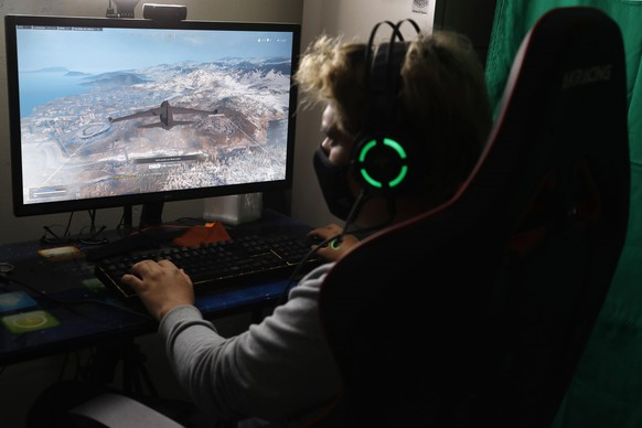 epa08724274 Mikhail Huacan plays Call of Duty Warzone online with other Latin American players, from his home in Lima, Peru, 04 October 2020 (issued 06 October). 2020 has undoubtedly been a bad year for everyone ... except for eSports, whose