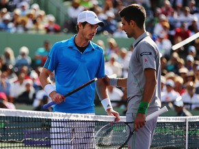 KEY BISCAYNE, FL - MARCH 26:  Andy Murray of Great Britain and Novak Djokovic of Serbia discuss whether Djokovic's raquet touched the net during a point during their match on day 10 of the Sony Open at Crandon Park Tennis Center on March 26, 2014 in Key Biscayne, Florida.  (Photo by Al Bello/Getty Images)