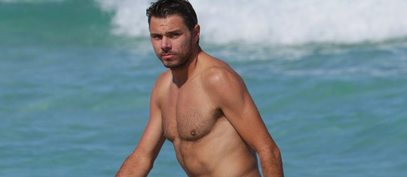 """Swiss tennis player Stanislas """"Stan"""" Wawrinka shirtless at the beach in Miami Beach, FL. Stan wore grey swim trunks as he took a swim in the ocean after being defeated in the Miami Open. <P> Pictured: Stan Wawrinka <B>Ref: SPL988329  300315  </B><BR/> Picture by: Pichichi<BR/> </P><P> <B>Splash News and Pictures</B><BR/> Los Angeles:310-821-2666<BR/> New York:212-619-2666<BR/> London:870-934-2666<BR/> photodesk@splashnews.com<BR/> </P>"""