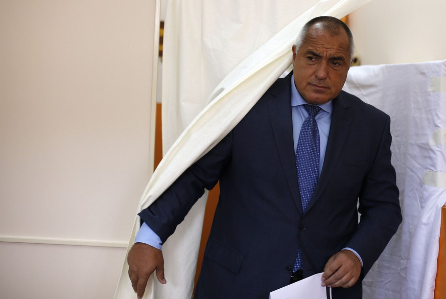 Boiko Borisov, leader of Bulgaria's centre right GERB party, walks out of a polling booth before casting his vote in Sofia October 5, 2014. Bulgarians began voting in a snap general election on Sunday, a poll that could leave them with another shaky coalition struggling to solve a festering bank crisis and revive growth in the European Union's poorest member state. Led by the former bodyguard and karate expert, the centre right GERB party is expected to win but fall short of a majority, which could spark a period of haggling with smaller parties and the opposition to shore up support.  REUTERS/Stoyan Nenov (BULGARIA - Tags: POLITICS ELECTIONS)