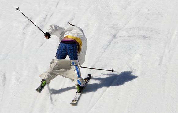 Sweden's Henrik Harlaut makes a hard landing before crashing during the men's ski slopestyle qualifying at the Rosa Khutor Extreme Park, at the 2014 Winter Olympics, Thursday, Feb. 13, 2014, in Krasnaya Polyana, Russia.(AP Photo/Gero Breloer)