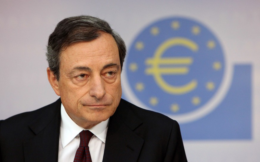 Mario Draghi, President of the European Central Bank (ECB) gives a press conference following the meeting of the ECB Governing Council in Frankfurt am Main, western Germany, on August 7, 2014. The ECB held its key interest rate steady at 0.15 percent at its regular policy meeting, two months after easing monetary conditions in the 18-country euro area. AFP PHOTO / DANIEL ROLAND