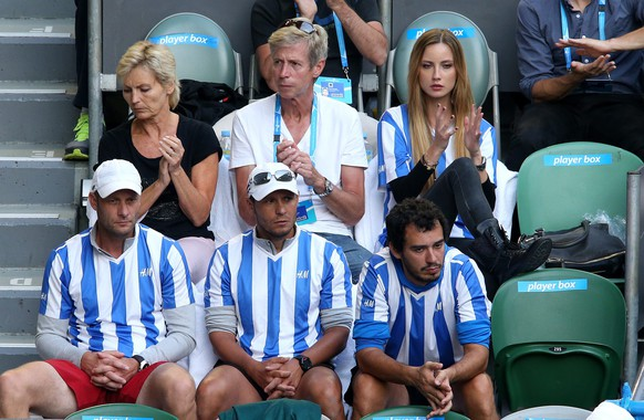 epa04037769 Ester Satorova (top, right) along with supporters of Tomas Berdych of the Czech Republic, watch his match against Stanislas Wawrinka of Switzerland in the semifinals of the Australian Open tennis tournament in Melbourne, Australia, 23 January 2014.  EPA/DAVID CROSLING